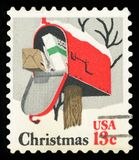 US Postage stamp. Open Christmas mailbox Stock Photography