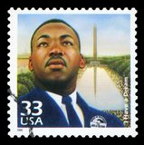 US Postage stamp. UNITED STATES OF AMERICA - CIRCA 1999: Stamp printed in USA dedicated to celebrate the century 1960s, shows Martin Luther King, circa 1999 royalty free stock photos