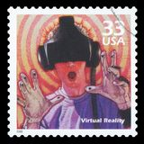 US - Postage Stamp. UNITED STATES OF AMERICA - CIRCA 2000: a postage stamp printed in USA showing an image of a man with futuristic glasses watching virtual stock image