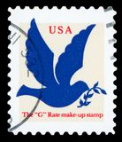 US Postage Stamp. UNITED STATES - CIRCA 1999: A stamp printed in United states shows dove, circa 1999 stock images