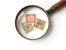 US postage stamps and magnifying glass stock image