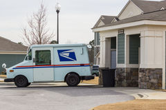 US Postal Service Mail Drop. A US Postal Service truck at an apartment mail drop for residents Royalty Free Stock Photography