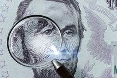5 USD, US money close up under magnifying glass Royalty Free Stock Photo