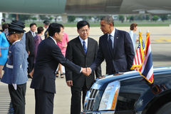 US President Barack Obama. Is greeted by a Thai government official as he arrives at Bangkok's Don Muang International Airport on the first day of a historic Royalty Free Stock Image
