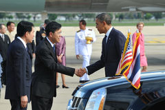 US President Barack Obama. Is greeted by a Thai government official as he arrives at Bangkok's Don Muang International Airport on the first day of a historic Royalty Free Stock Photo