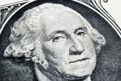 US president George Washington face portrait on the USA one dollar note. Macro shot. Background of the money. George Washington ey. Es macro shot royalty free stock photos
