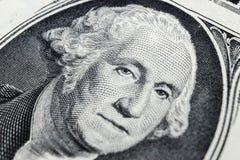US president George Washington face portrait on the USA one dollar note. Macro shot. Background of the money. George Washington ey. Es macro shot royalty free stock photography