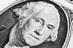 US president George Washington face portrait on the USA one dollar note. Macro shot. Background of the money. George Washington ey. Es macro shot. Black and royalty free stock photo