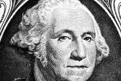 US president George Washington face portrait on the USA one dollar note. Macro shot. Background of the money. George Washington ey. Es macro shot. Black and stock photo