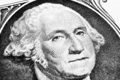 US president George Washington face portrait on the USA one dollar note. Macro shot. Background of the money. George Washington ey. Es macro shot. Black and royalty free stock photos