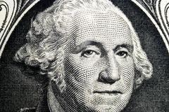 US president George Washington face portrait on the USA one dollar note. Macro shot. Background of the money. George Washington ey. Es macro shot royalty free stock image