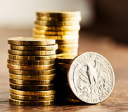 Us quarter dollar coin and gold money Royalty Free Stock Images