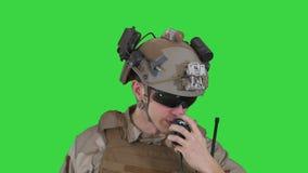US ranger in uniform talking on radio on a Green Screen, Chroma Key.