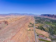 Mesa and canyon landscape, Moab, Utah, USA. US Route 191 and La Sal Mountains aerial view near Arches National Park, Moab, Utah, USA stock images