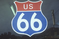 A US route 66 sign hanging in a window Royalty Free Stock Photography