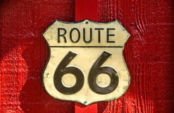 US Route 66 Sign. On a red building on The Mother Road stock photography