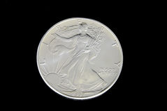 US Silver Dollar. American silver dollar in on black background Stock Photo