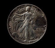 US silver liberty dollar  on black. Closeup macro shot Royalty Free Stock Photo