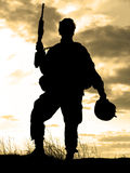 US soldier. Silhouette of US soldier with rifle against a sunset Stock Photography