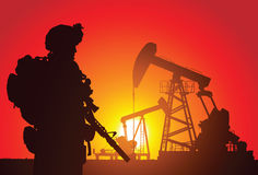 US soldier. With oil rigs on the background Stock Images