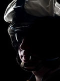 US soldier. In the helmet on the black background Stock Photo