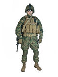 US soldier. With his assault rifle on white background stock photography
