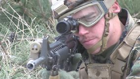 US soldier aims target. A US soldier knee on ground and aim a target with his weapon stock footage