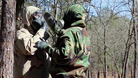 US Soldier Clean Gas Mask In Forest Rifle stock footage