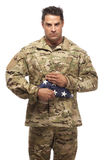 US Soldier holding folded flag Royalty Free Stock Images