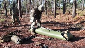US Soldier Military Training Fix Person Litter. A US soldier fix at a military training a person in a litter stock video