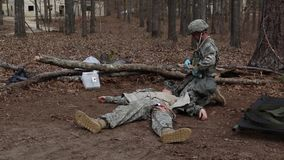 US Soldier Takes Stethoscope Injured Person stock footage