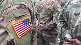 US soldiers. US army. USA patch flag on the US military uniform. Soldiers on the parade ground from the back. Veterans Day. Memori