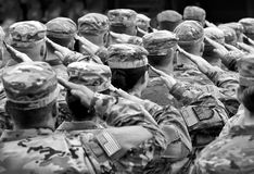 US soldiers giving salute, BW.  Royalty Free Stock Photo