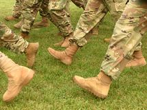 US soldiers legs in green camouflage military uniform. US troops.  stock image