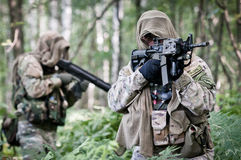 US soldiers on patrol. U.S. Special forces soldiers in forest during patrol, seeking for enemy Stock Photography