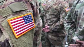 US soldiers. US army. USA patch flag on the US military uniform. Soldiers on the parade ground from the back.