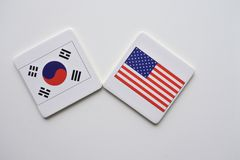 US and South Korea flags on white background royalty free stock photo