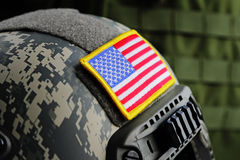 US Spec Ops Tactical Gear. USA flag on a modern military helmet close-up. Shallow DOF Stock Image