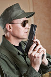 US Special Forces soldiers in uniform and with pistol Royalty Free Stock Images