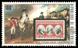 US Stamp and Surrender at Yorktown. Upper Volta - stamp 1975: Color edition on American Bicentennial Art, shows US Stamp and Surrender at Yorktown Stock Photography