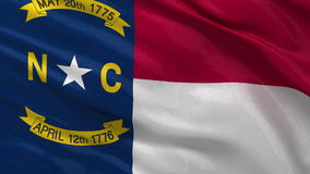 US state flag of North Carolina - seamless loop. US state flag of North Carolina gently waving in the wind. Seamless loop with high quality fabric material stock video footage