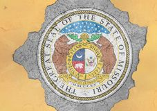 US state Missouri seal flag painted on concrete hole and cracked wall. Facade structure royalty free stock images