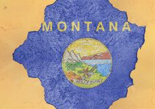 US state Montana flag in big concrete cracked hole and broken wall. US state Montana flag in big concrete cracked hole and broken material facade structure royalty free stock image