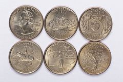 1999 US State Quarters a complete set of 5 used coins. Are located in the order of their released and joining the state Stock Images