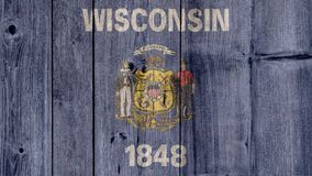 US State Wisconsin Flag Wooden Fence. USA Politics News Concept: US State Wisconsin Flag Wooden Fence stock image