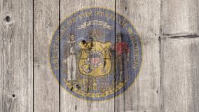 US State Wisconsin Seal Wooden Fence. USA Politics News Concept: US State Wisconsin Seal Wooden Fence Background stock photos