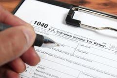 US-Steuerformular 1040 auf Tabelle Lizenzfreies Stockbild