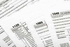 1040,1120,1065 US-Steuerformular/Besteuerungskonzept Lizenzfreies Stockbild