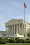 US Supreme Court. The front of the US Supreme Court in Washington, DC. American flag on a mast in foreground Stock Photography