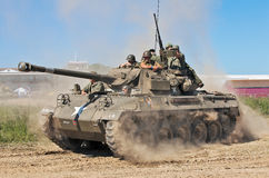 US tank in duat. WESTERNHANGER, UK - JULY 19: A replica US M16 tank destroyer speeds around the show arena in a cloud of dust during the War & Peace show on July Royalty Free Stock Photo